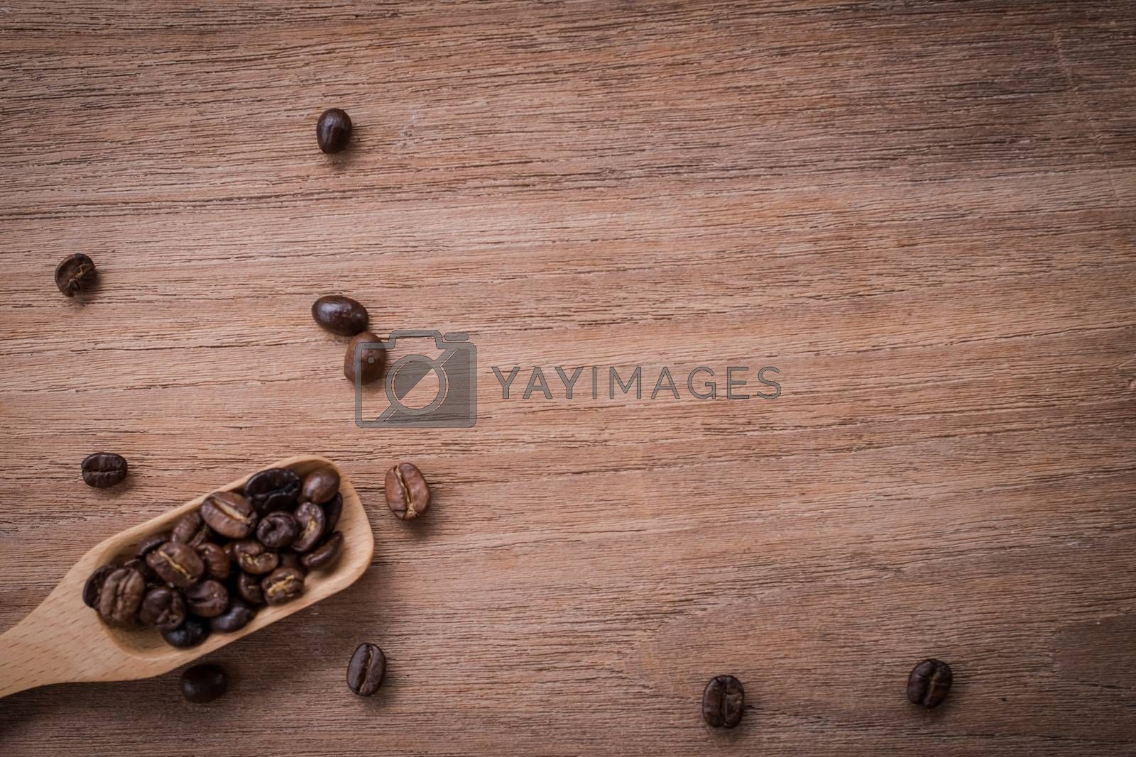 coffee beans isolated on wood background