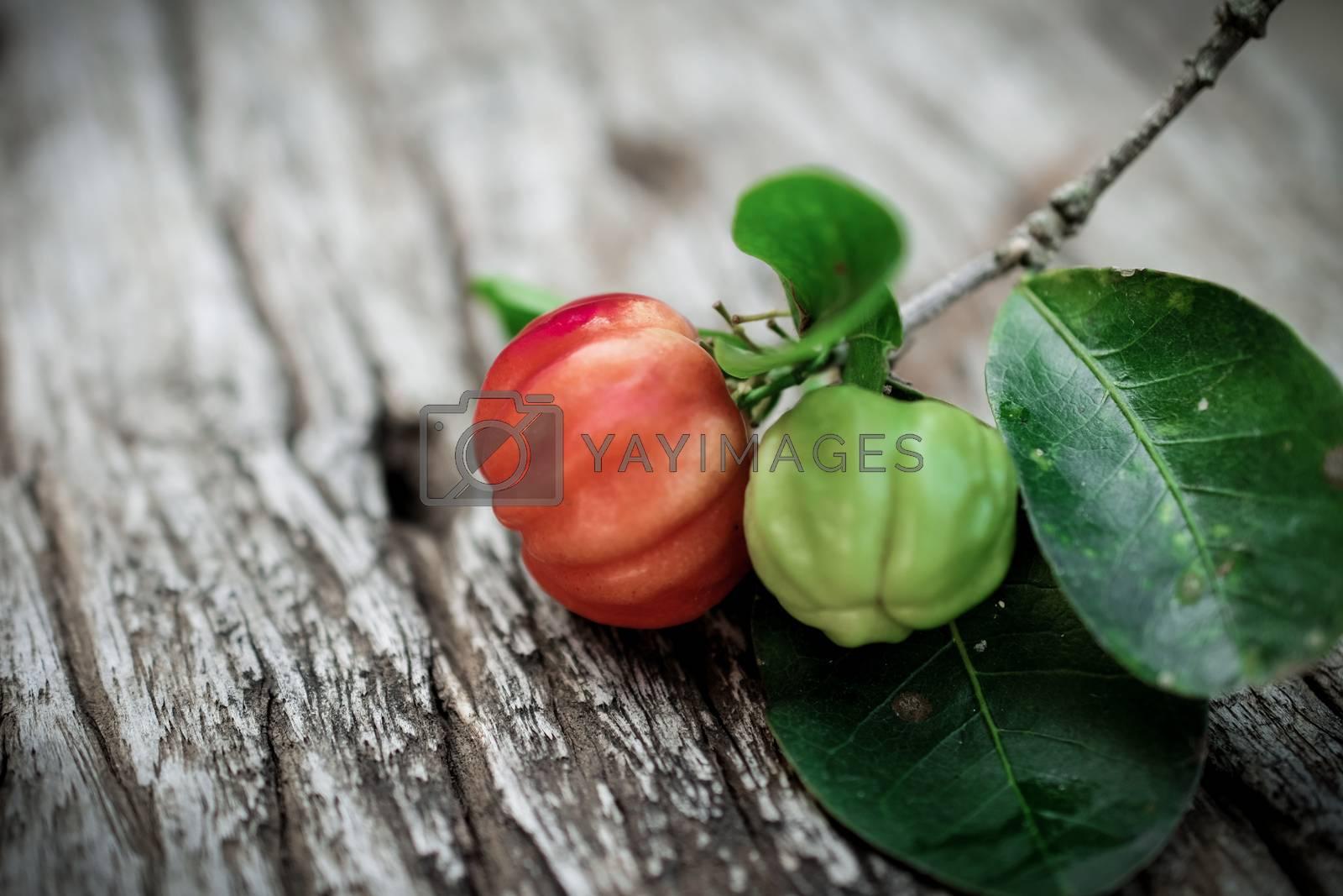 Acerola fruit on wood background
