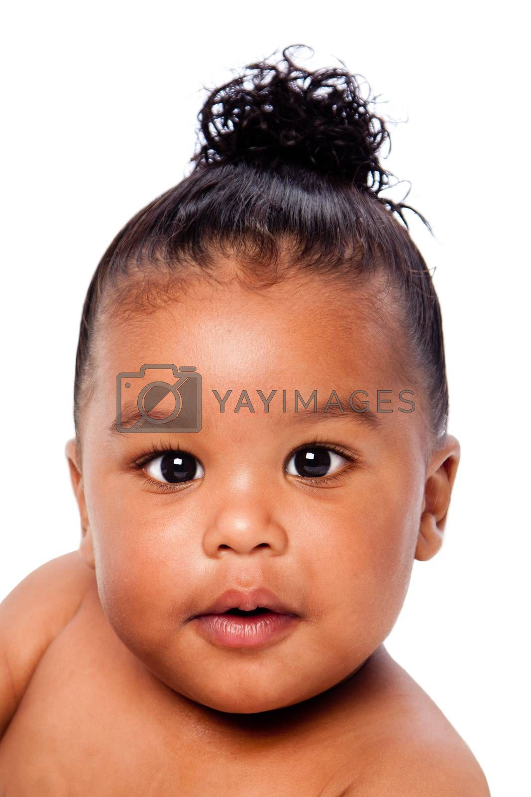 Face of beautiful cute baby toddler with hair in bun.