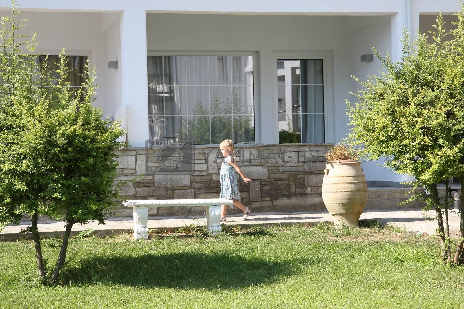 Cute baby girl proudly walking in resort