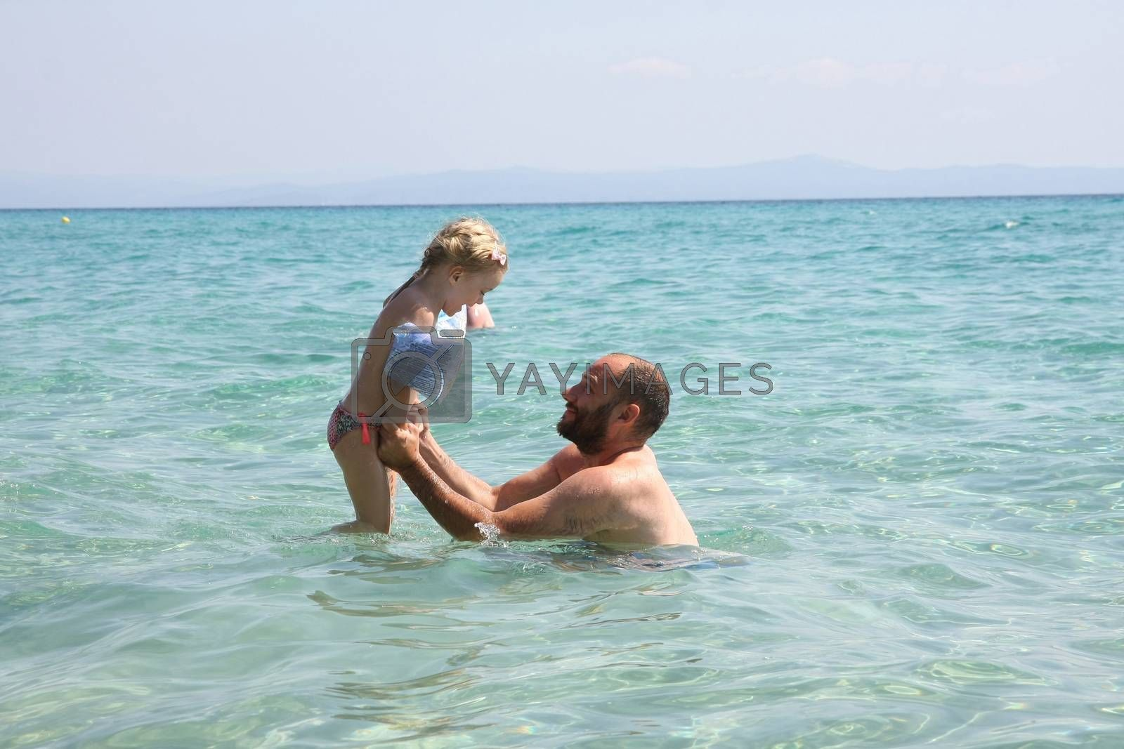 Father and daughter in the sea by tdjoric