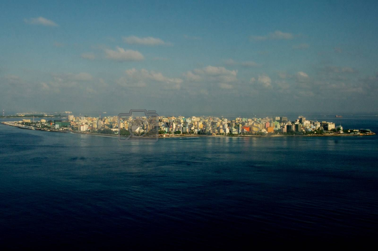 Aerial View of Male Maldivian Capital on Blue Sky with Clouds Early Morning Outdoors