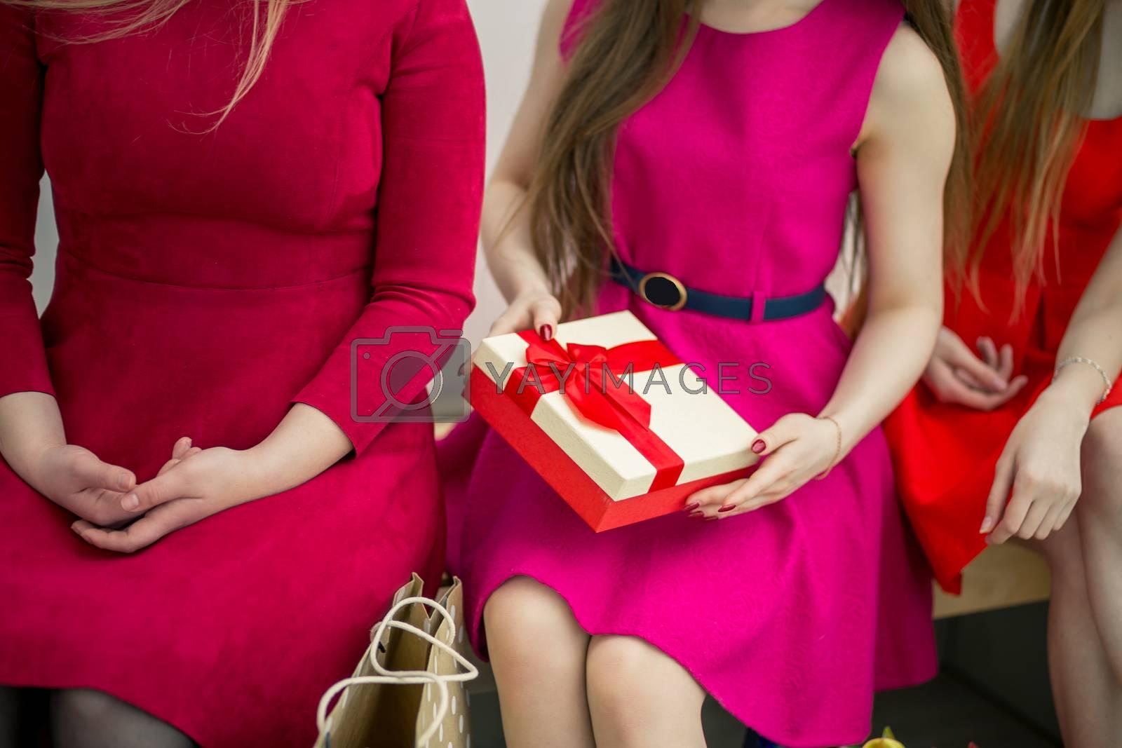 crop photo of shopping woman sitting at bench at mall