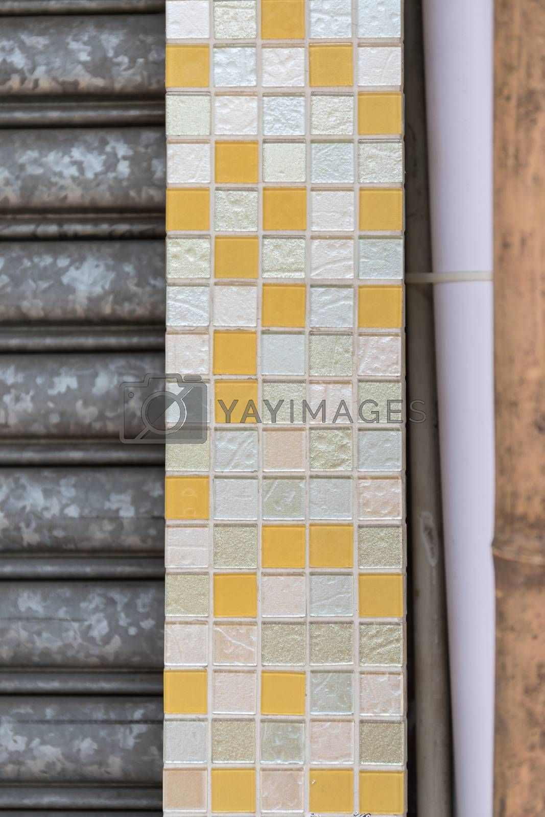 Yellow and White Mosaic Tiled Wall Decoration