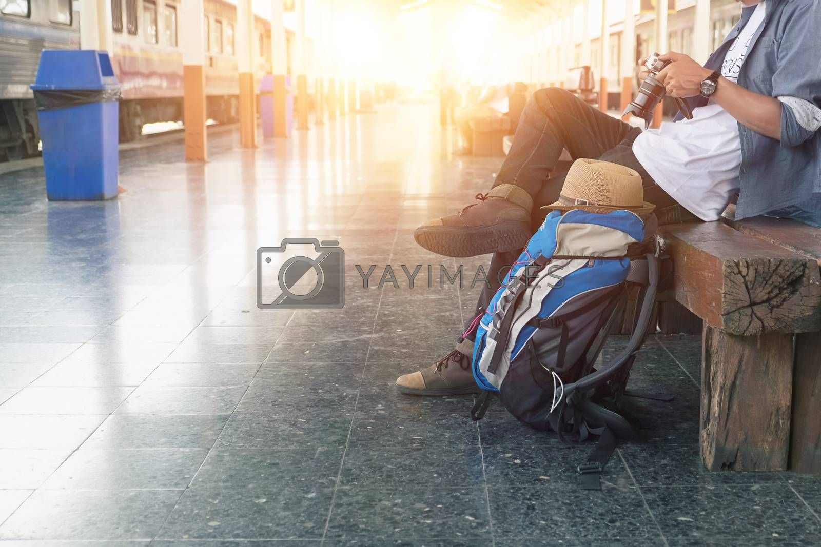 Backpacker at the train station with a traveler. Travel concept.