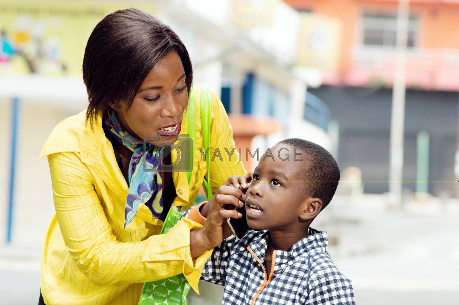 A young woman making listen her communication by her child.