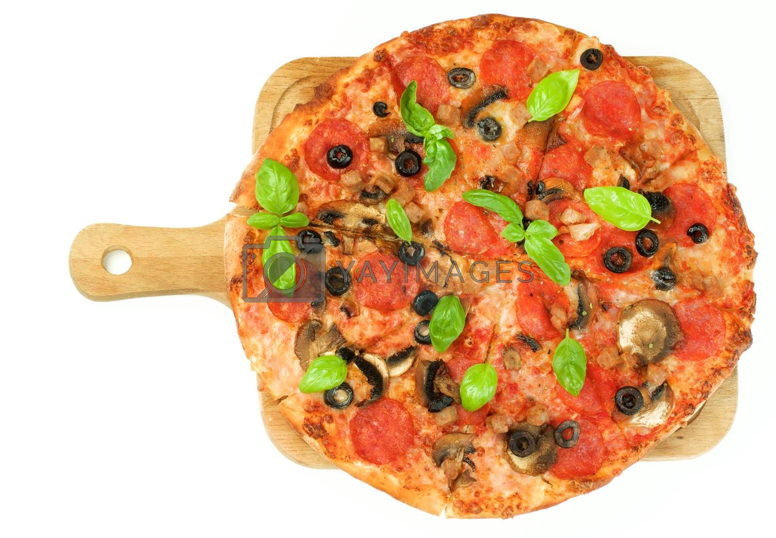 Homemade Pepperoni Pizza with Mushrooms, Black Olives, Ham and Basil on Wooden Cutting Board on White background. Top View