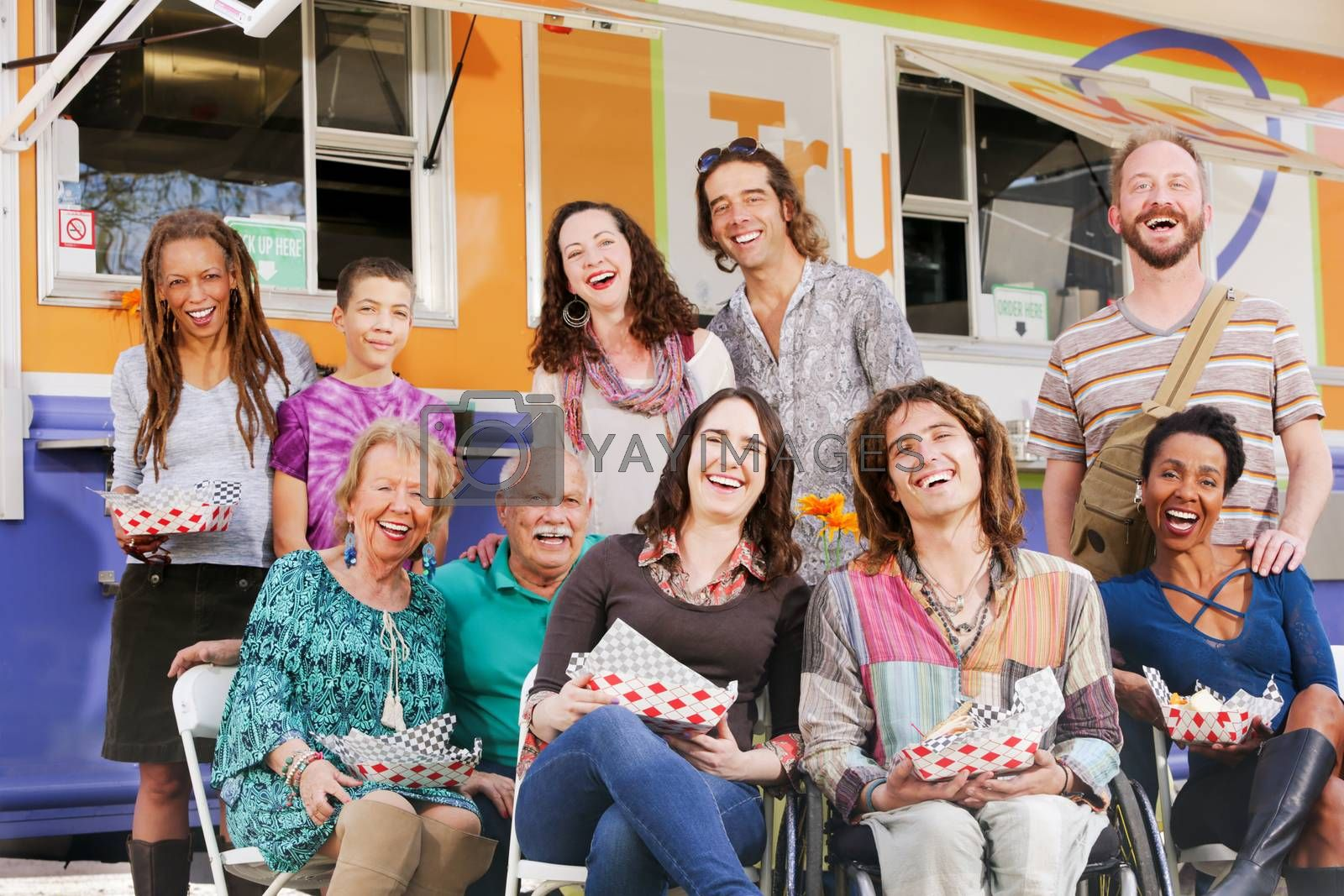 Happy diverse group laughing together outside of a food truck