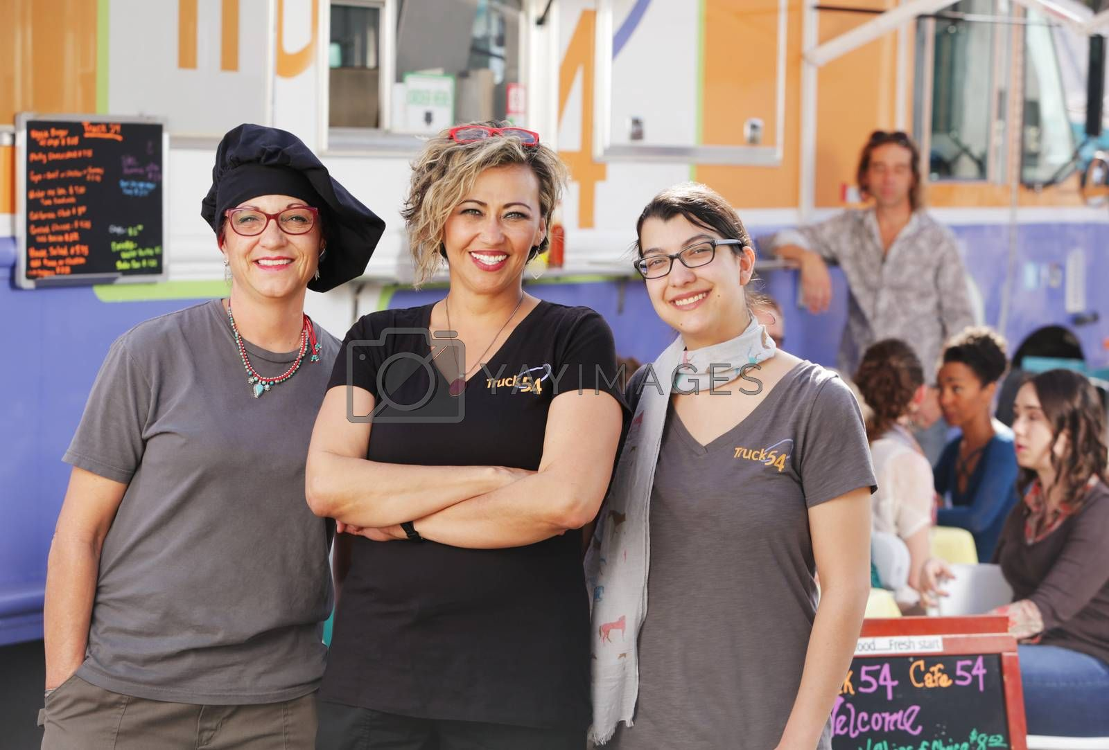Three smiling female food truck entrepreneurs by Creatista