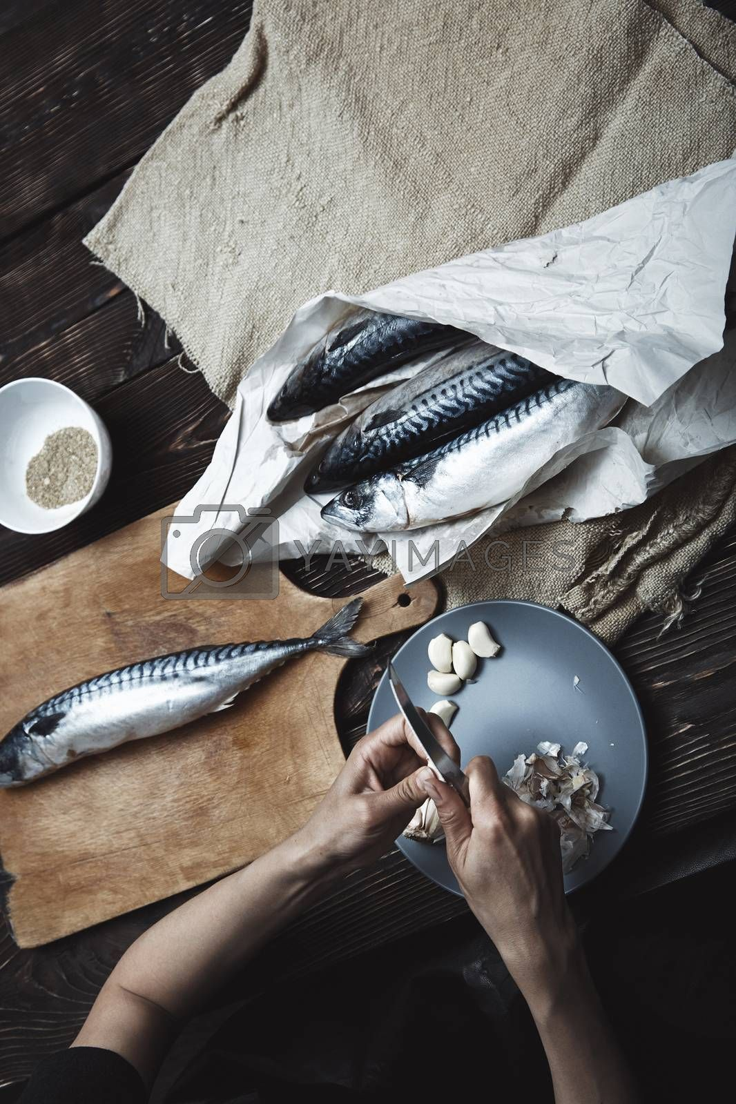 Woman preparing fish