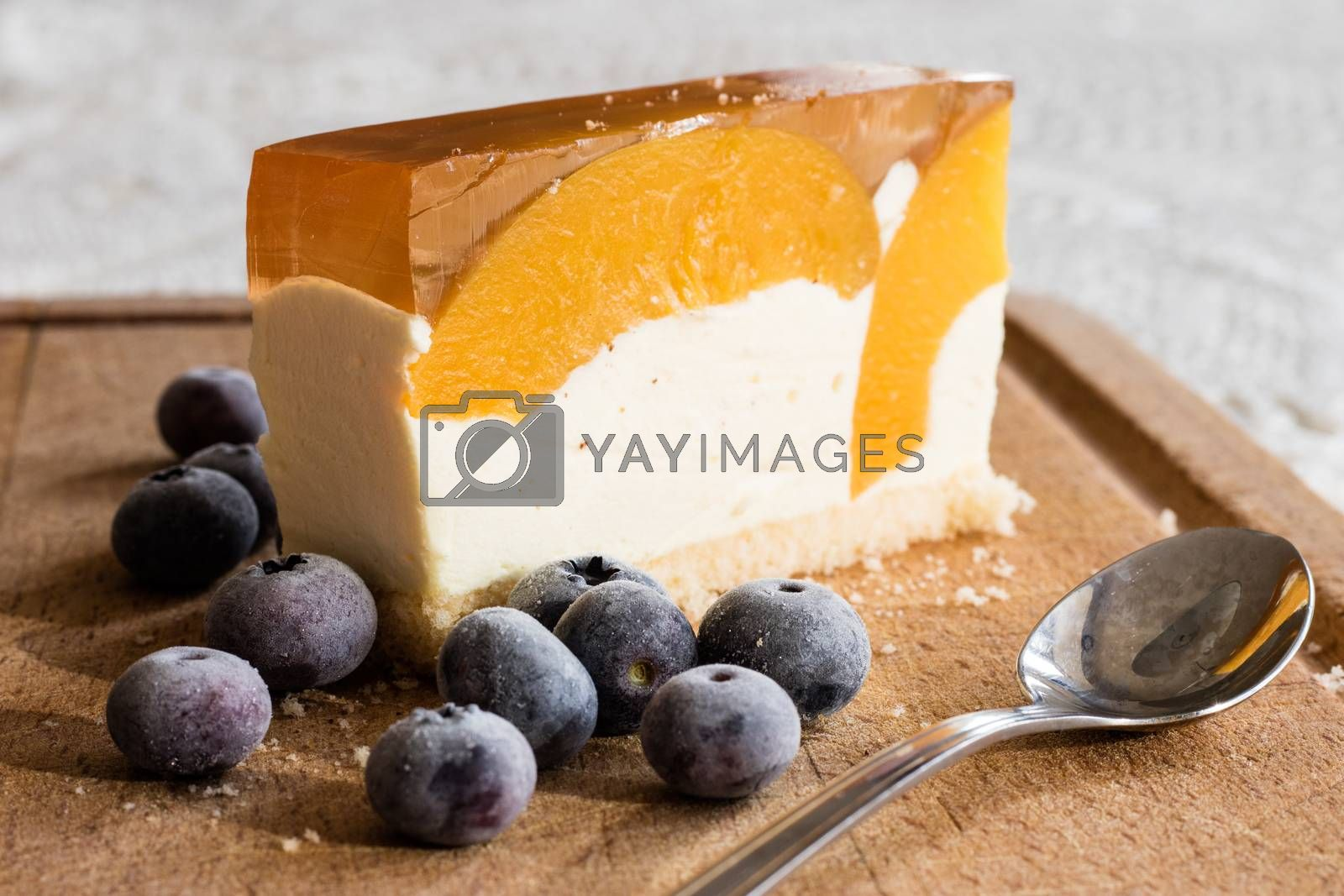 Delicious and sweet cake with blueberries. Sunny dessert on the  by wytrazek