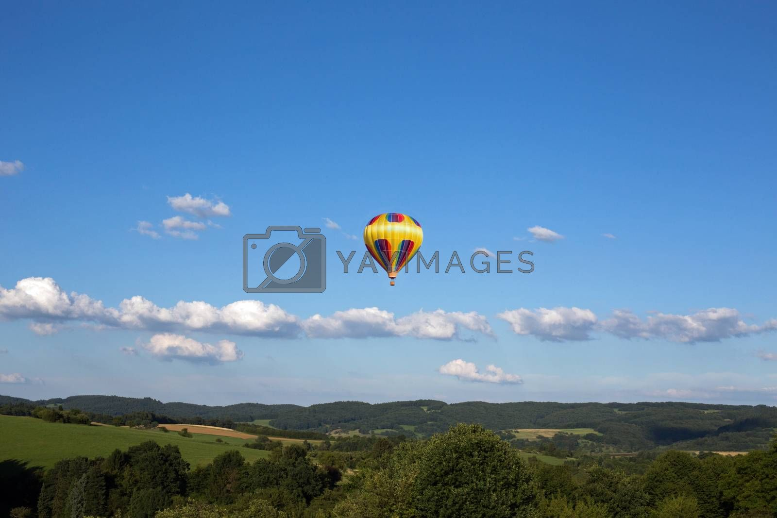 Hot air balloon, photographed against the blue cloudless sky