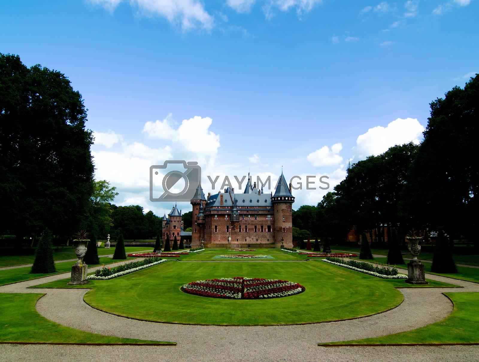 Medieval Castle De Haar from side of Flower Garden Alley against Blue Sky Outdoors. Utrecht, Netherlands