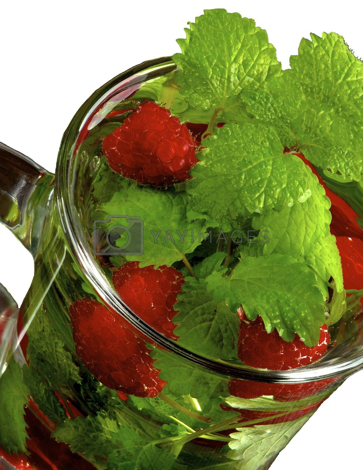Raspberry Beverage with Perfect Fresh Lemon-Balm Leafs in Glass Cup on White background