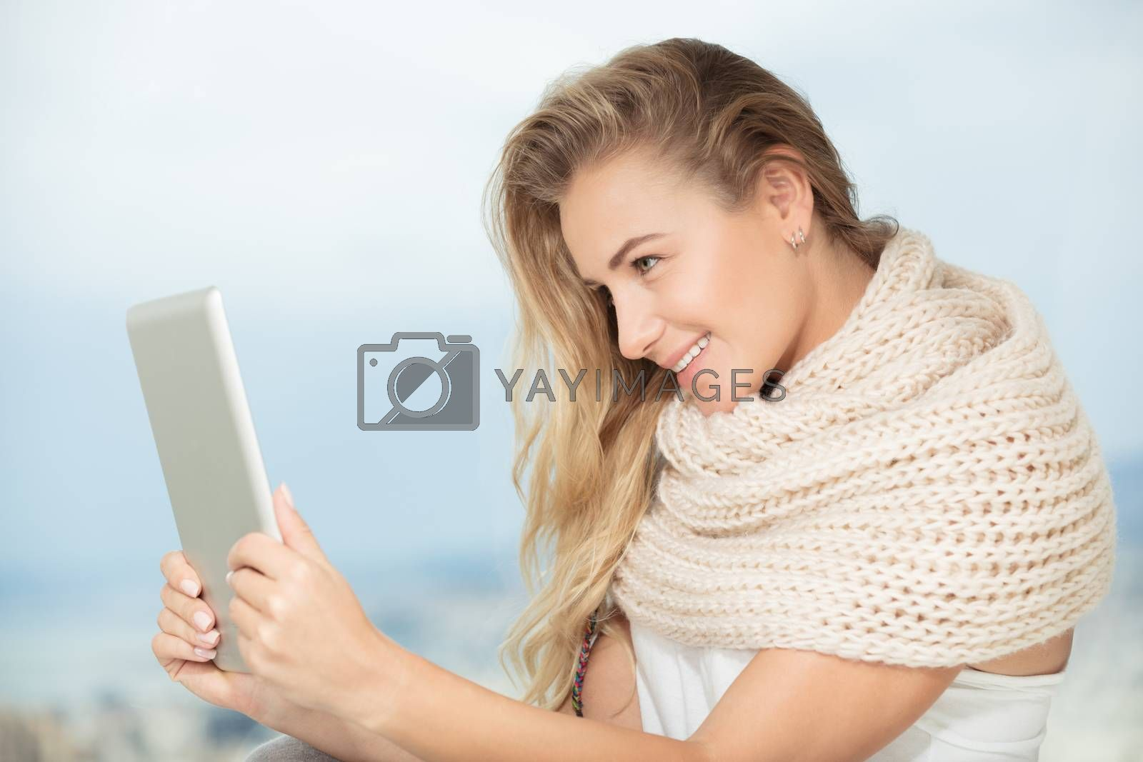 Portrait of a nice happy girl communicate with someone on the touchpad, using modern technology for communication with friends