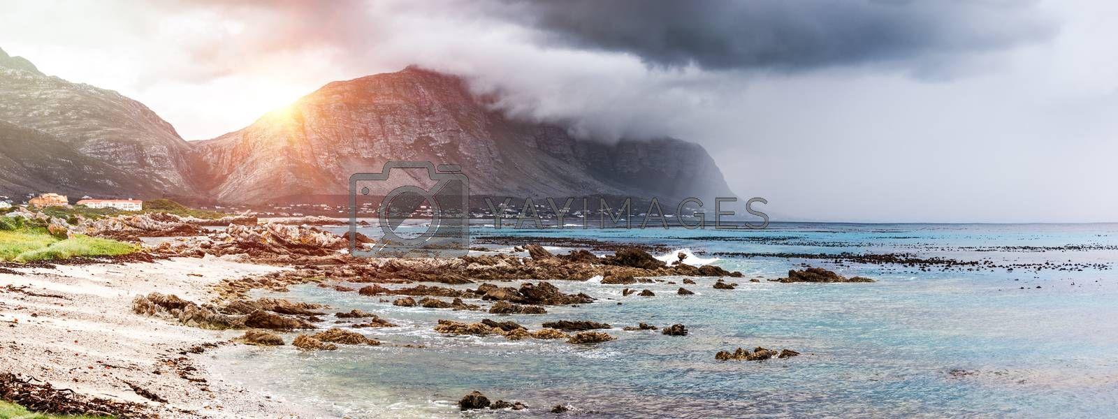 Beautiful landscape of Betty's Bay, mountains in the fog near seashore, amazing panoramic view, beauty of wild nature, Atlantic Ocean, South Africa