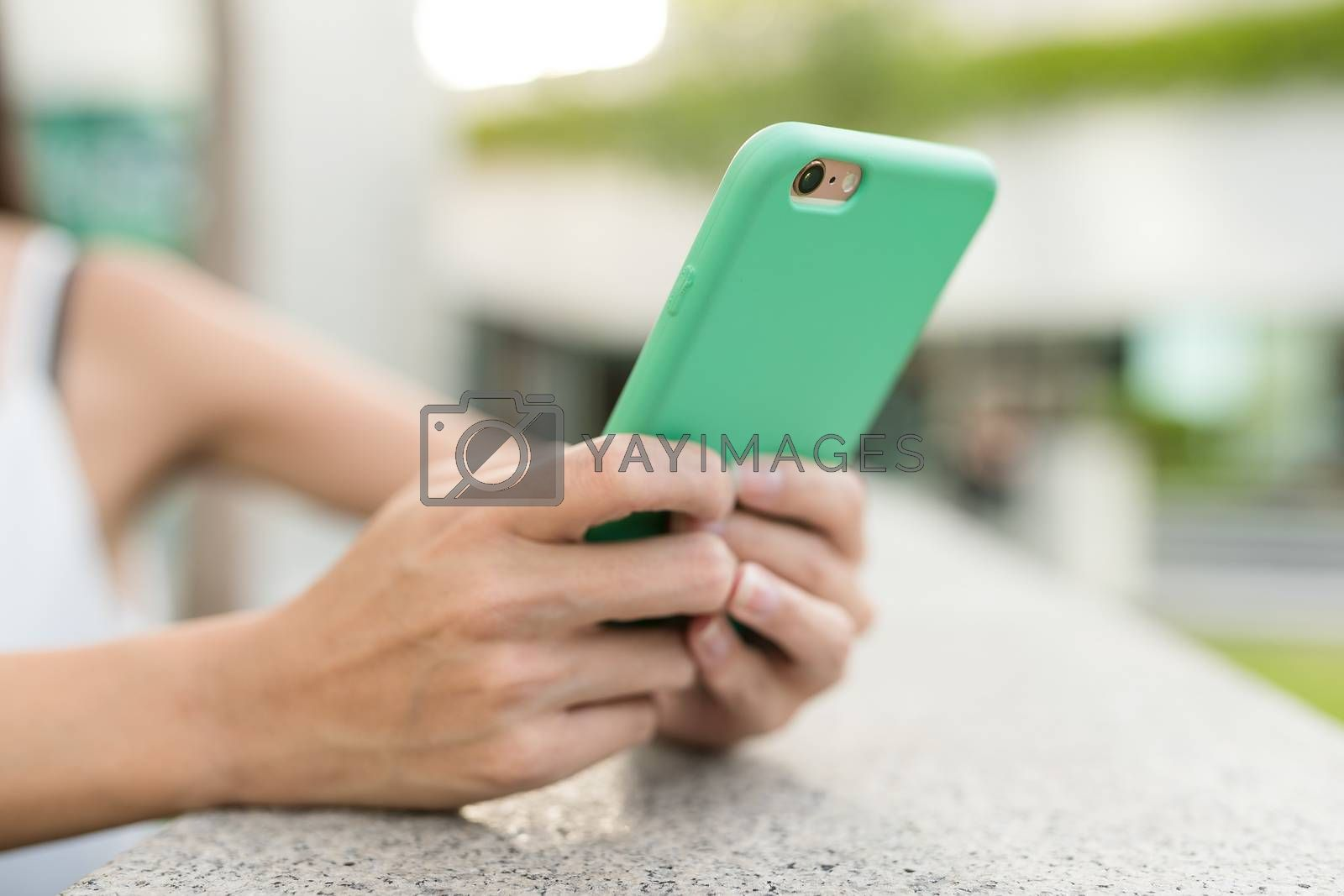Woman using mobile phone in the street
