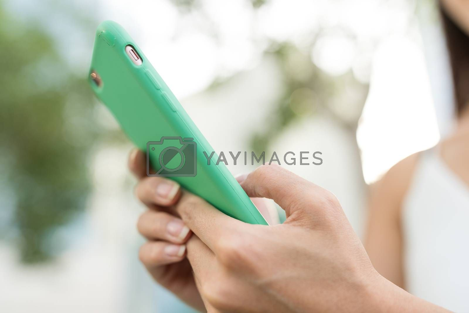 Hand typing on smart phone