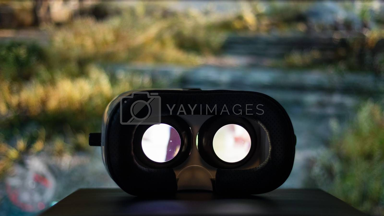 Royalty free image of Virtual reality device playing movie inside by leungchopan