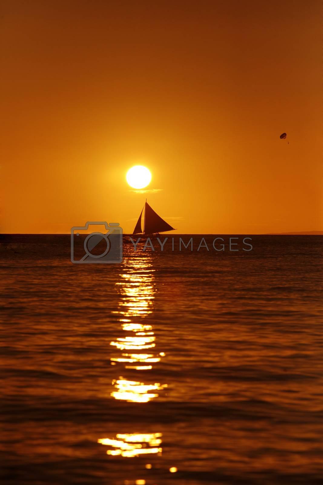 Drifting boat on a sunset. Coast of the Pacific ocean. Island Boracay