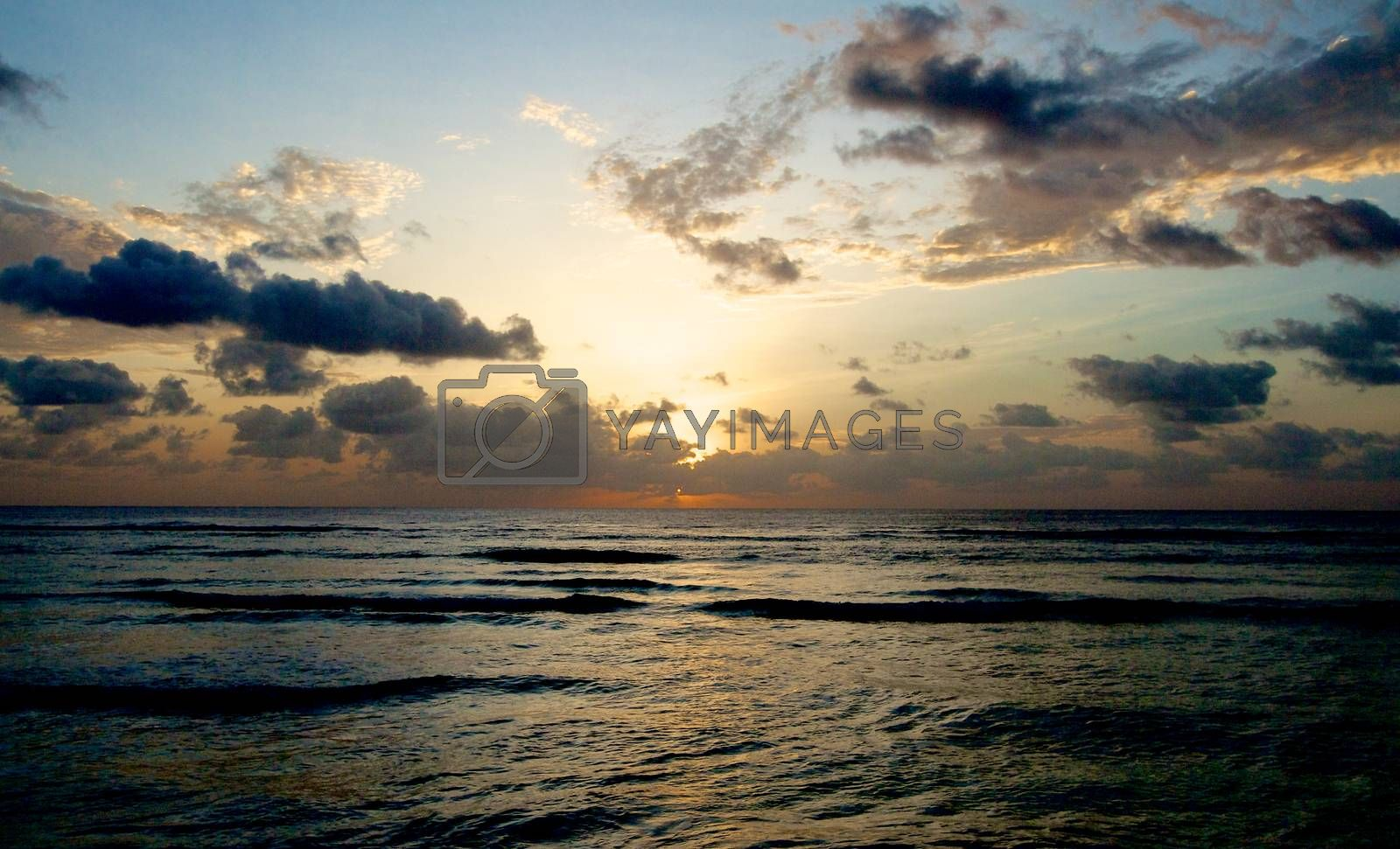 Beautiful Sunrise with Dramatic Clouds over Waves Horizon Outdoors. Indian Ocean, Maldives