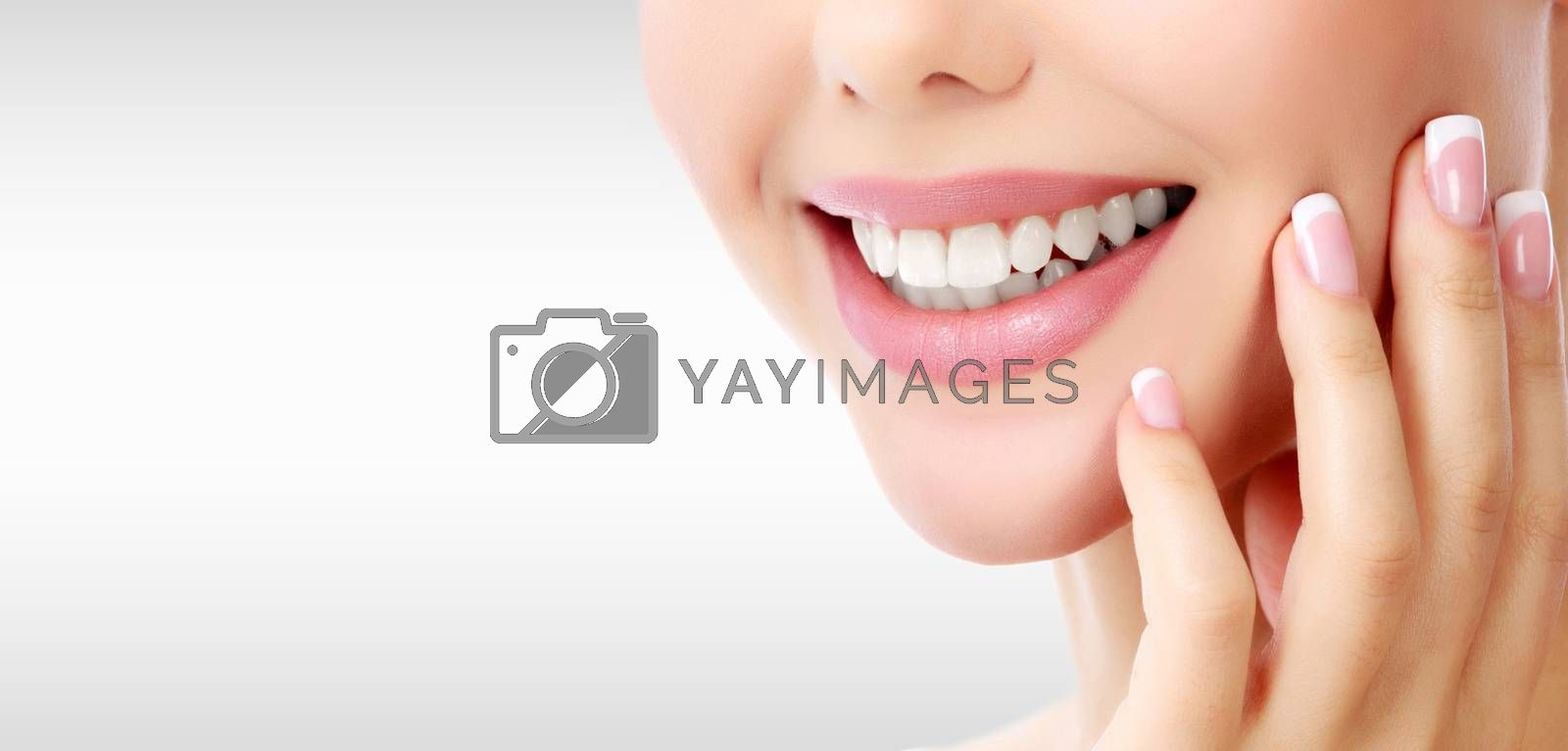 Closeup shot of woman's toothy smile against a grey background w by Nobilior