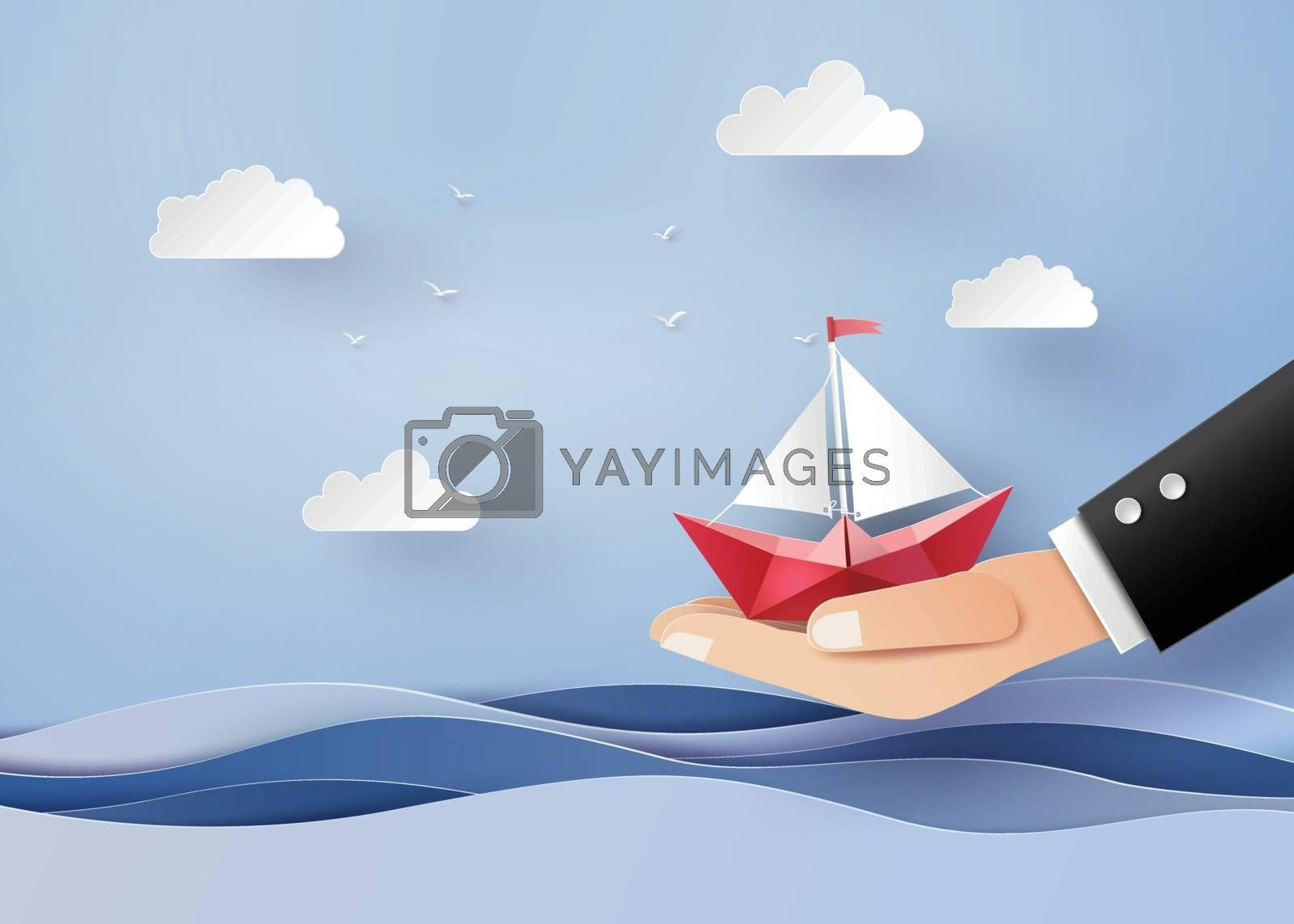 bussiness concept of freedom and believe ,origami made paper sailing boat on hand. The illustrations do the same paper art and craft style
