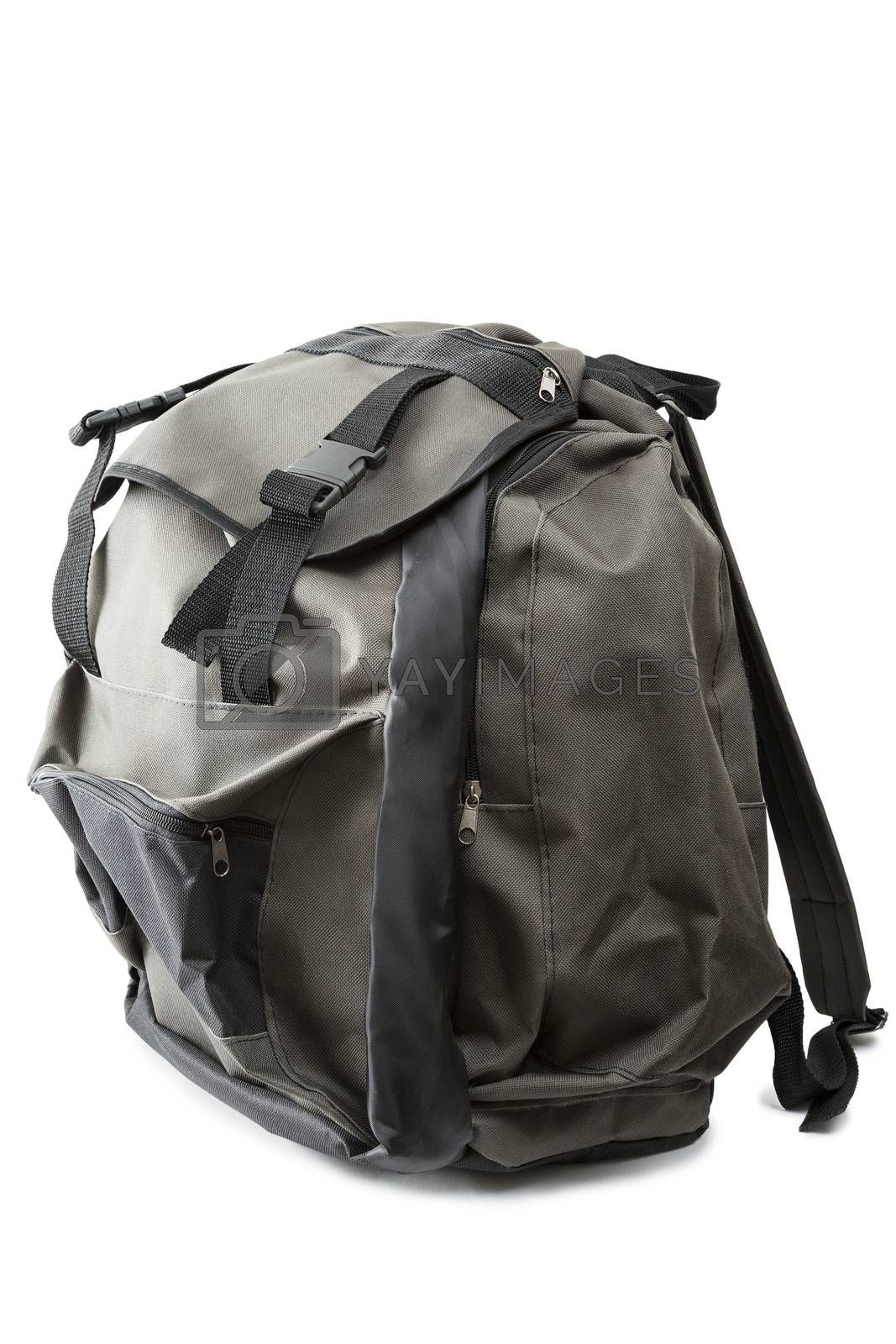 A small backpack is isolated on a white background