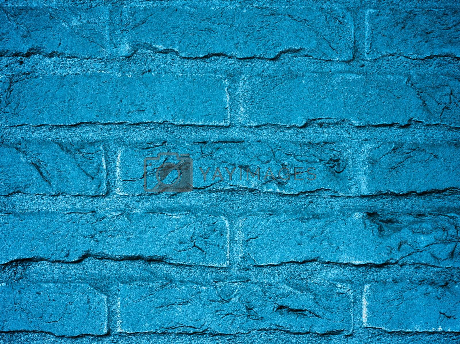 Background of Blue Brick Wall with Cracked Surface and Cobweb in Corners closeup Outdoors