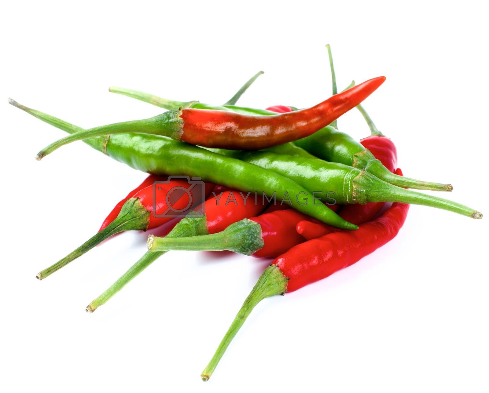 Arrangement of Perfect Red and Green Hot Chili Peppers isolated on White background