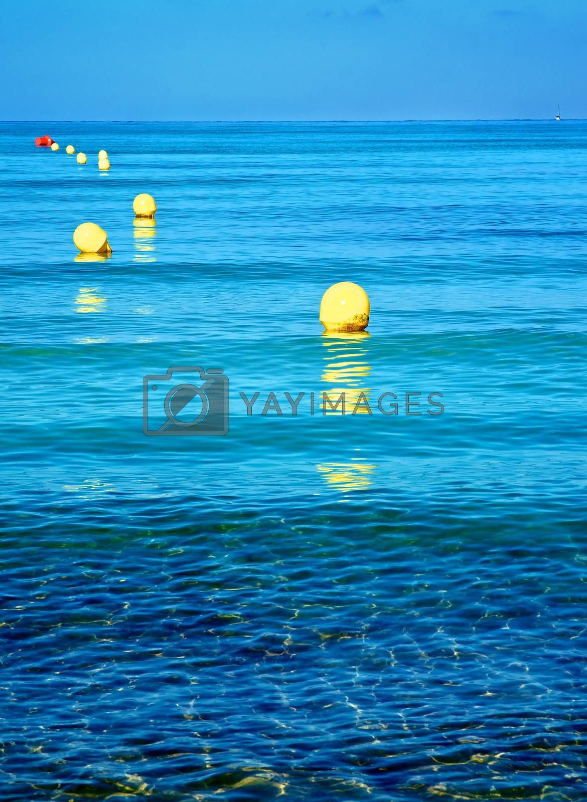 Yellow Boundary Mark Floats on Ripple Sea Water Surface on Blue Sky Horizon Outdoors
