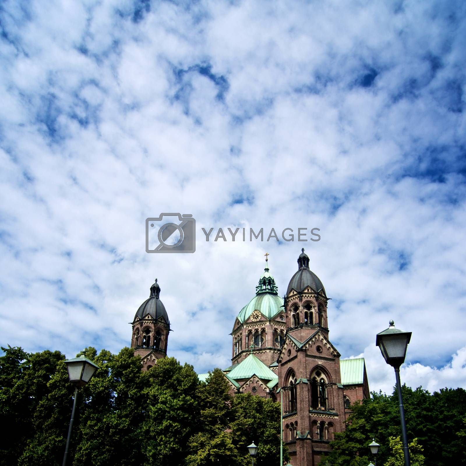 Domes of St. Lukas Church - Lukaskirche against Cloudy Sky Outdoors. Munich, Bavaria, Germany
