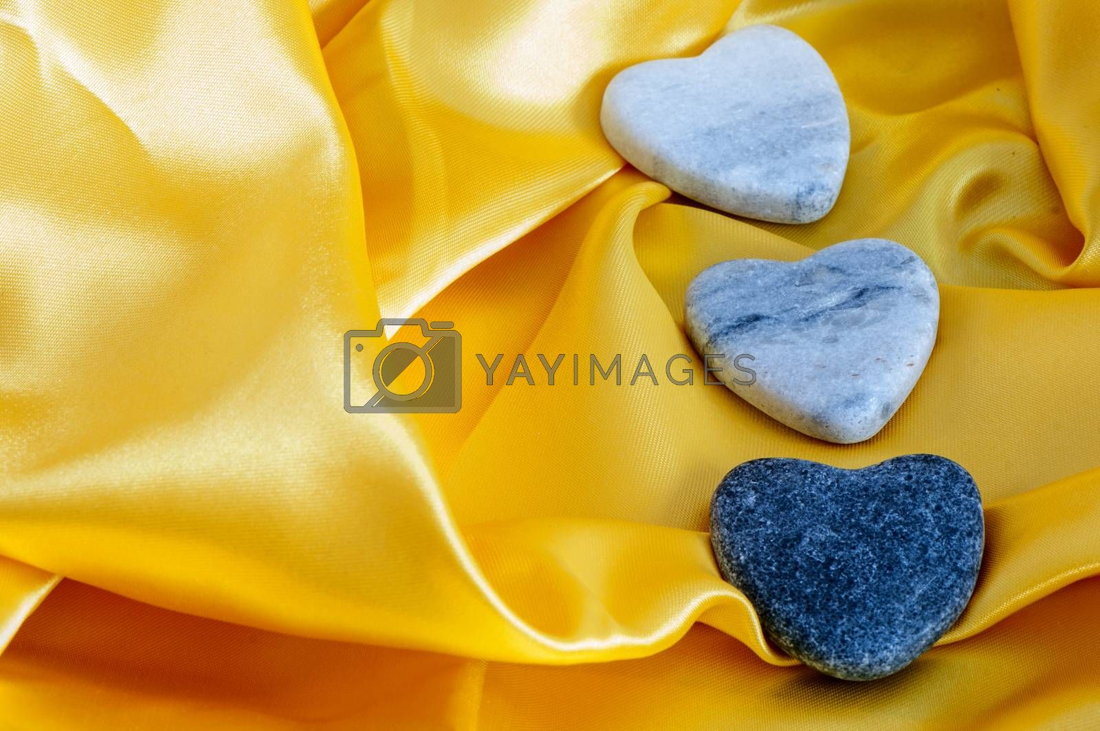 Royalty free image of three stone hearts by carla720