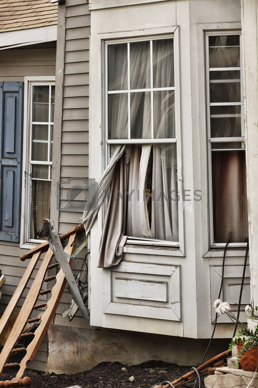 Wooden house damaged by disaster.