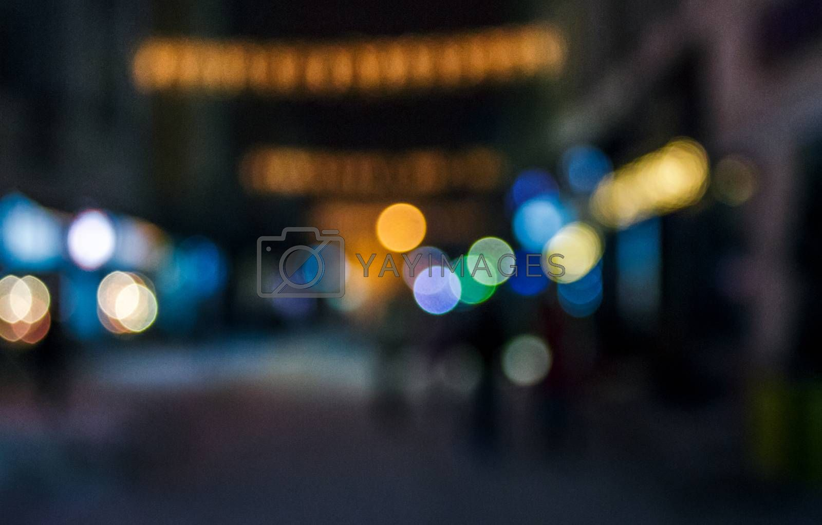 people moving on the old european city winter night street defocused blurred abstract image