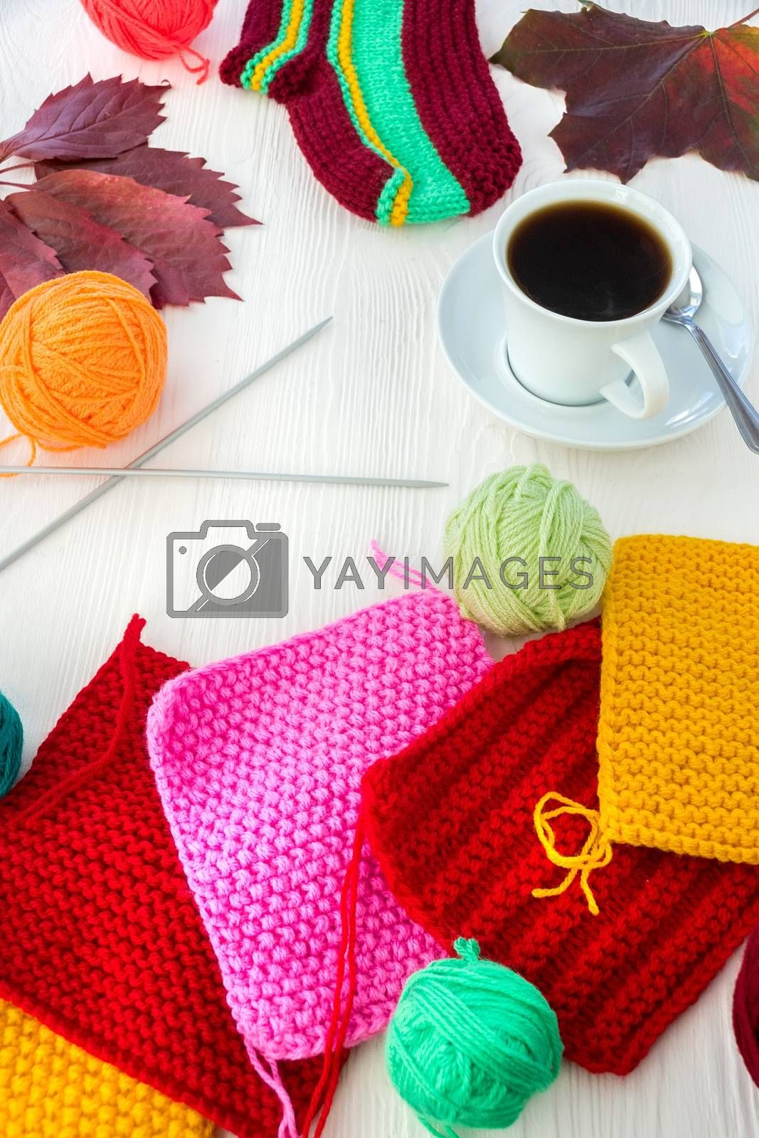 Autumn knitting with a mug of coffee on a white background
