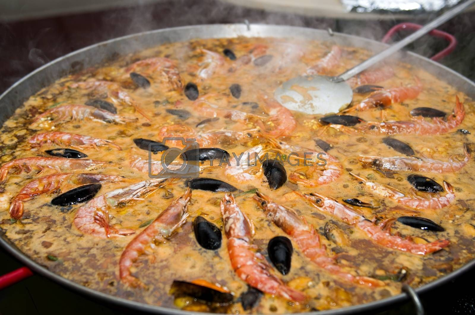 big paella pot that has just been cooked