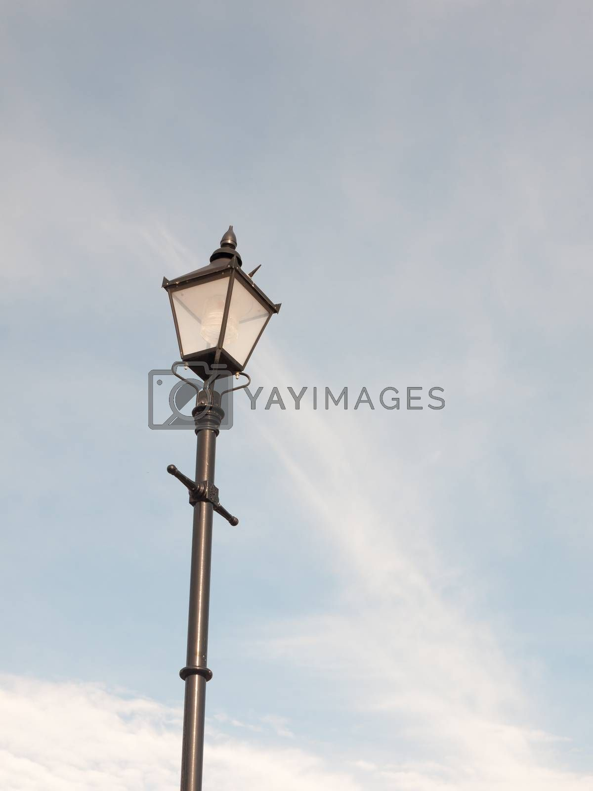 black outside street lamp with blue and cloud sky; Essex; England; UK