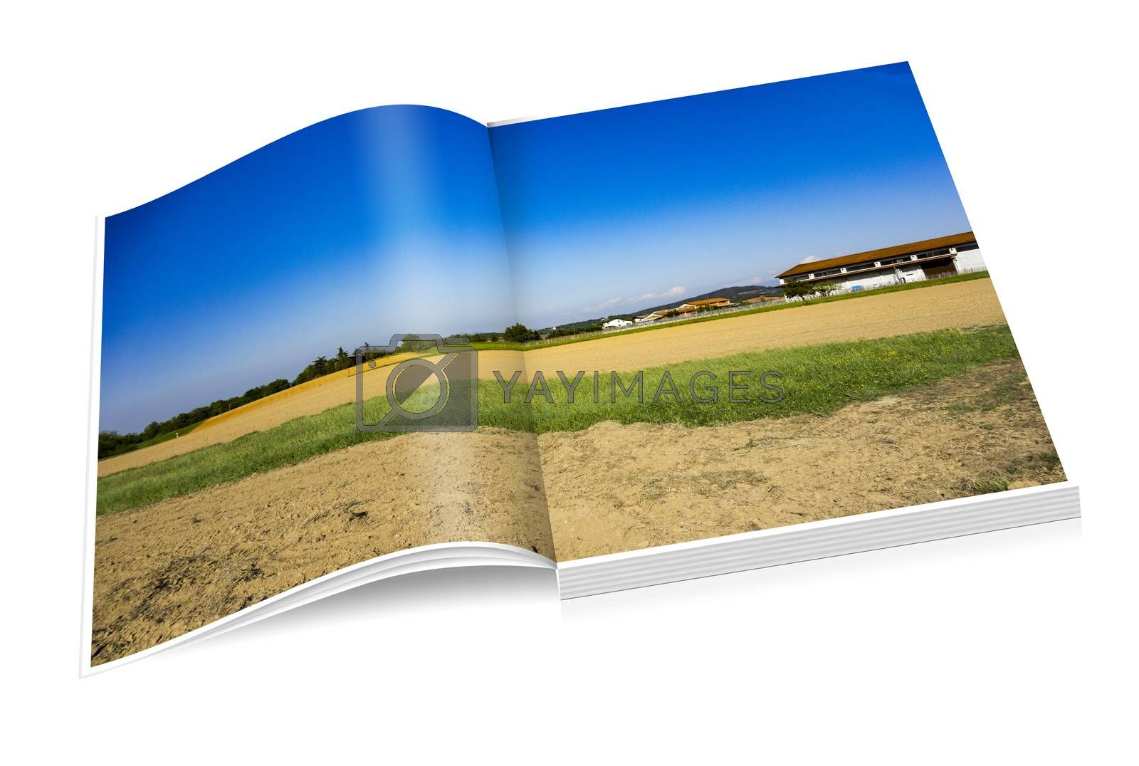book of fields, cellar and village in the distance