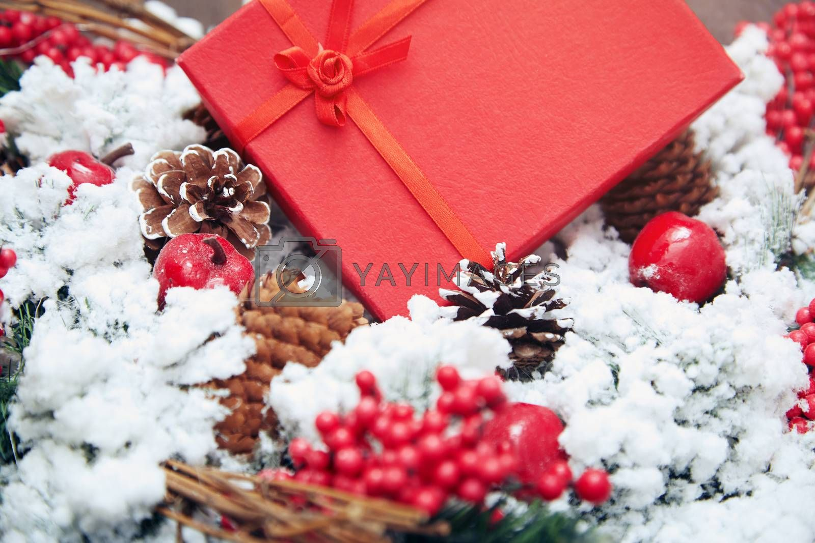 Christmas gift in a red box. Close-up horizontal photo