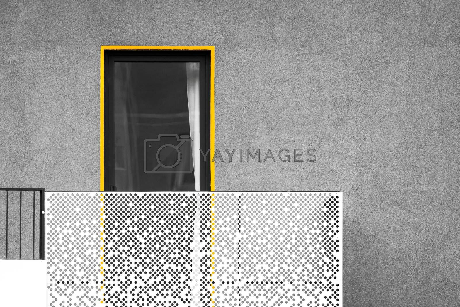 Abstract modern architecture with balcony and window. Black and white picture with yellow detail standing out