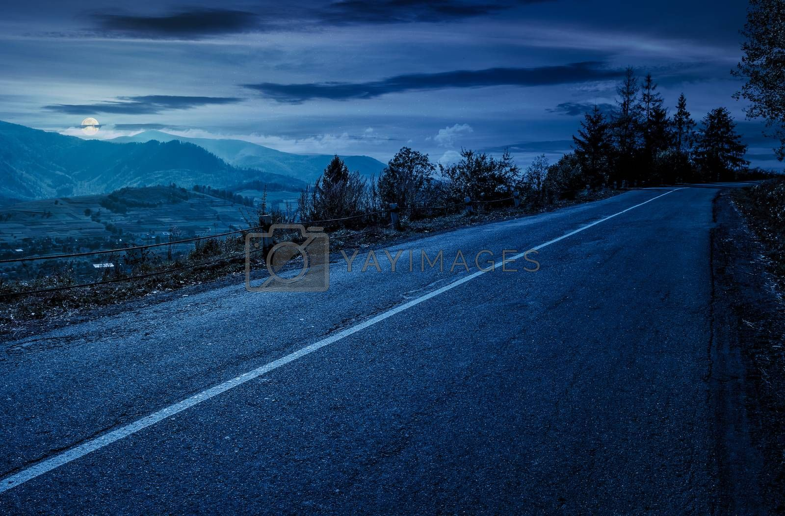 countryside road through mountains at night by Pellinni