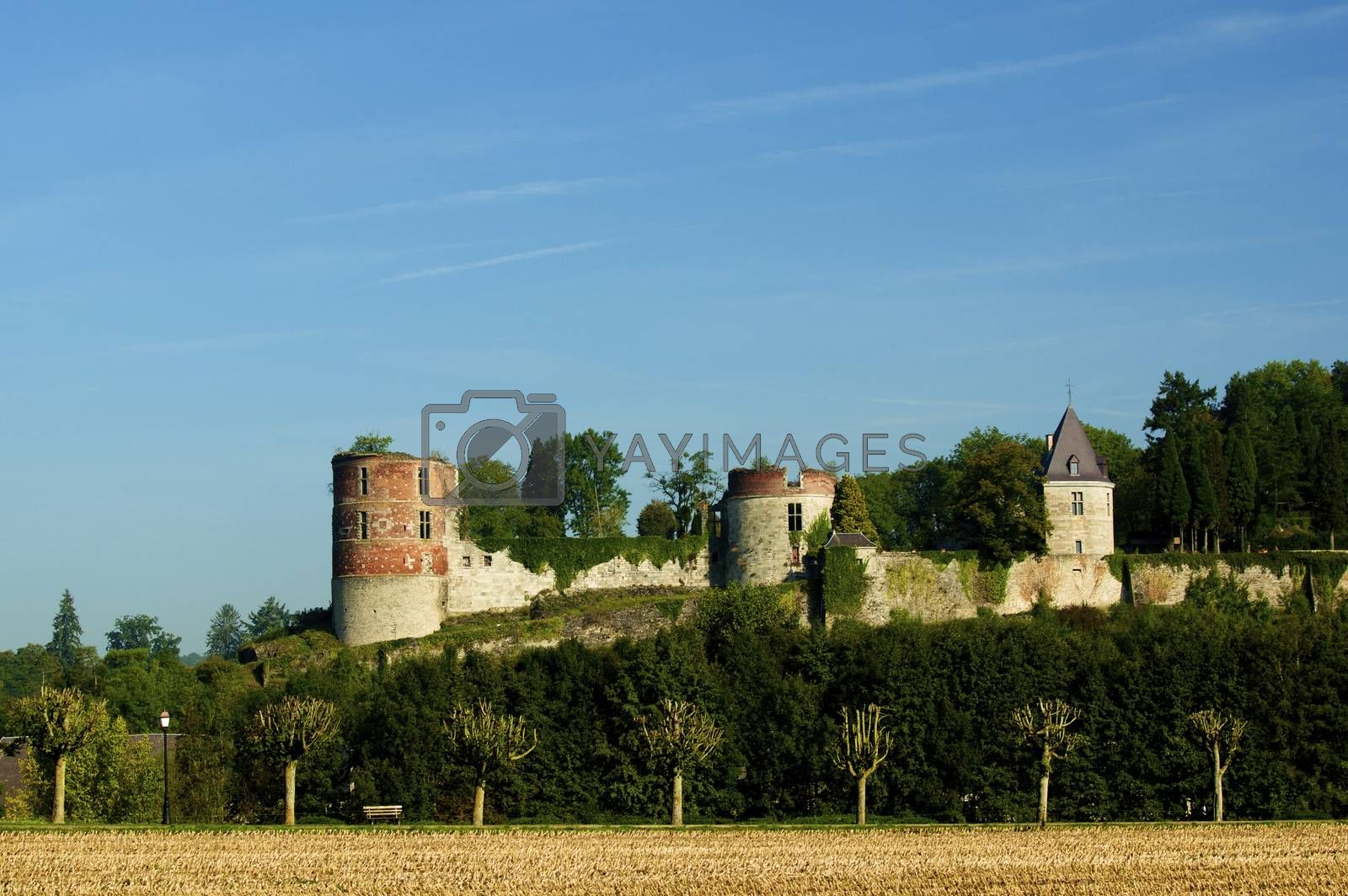 Castle of Hierges - Château de Hierges - with Tree Alley on Blue Sky background Outdoors. Ardennes region of France
