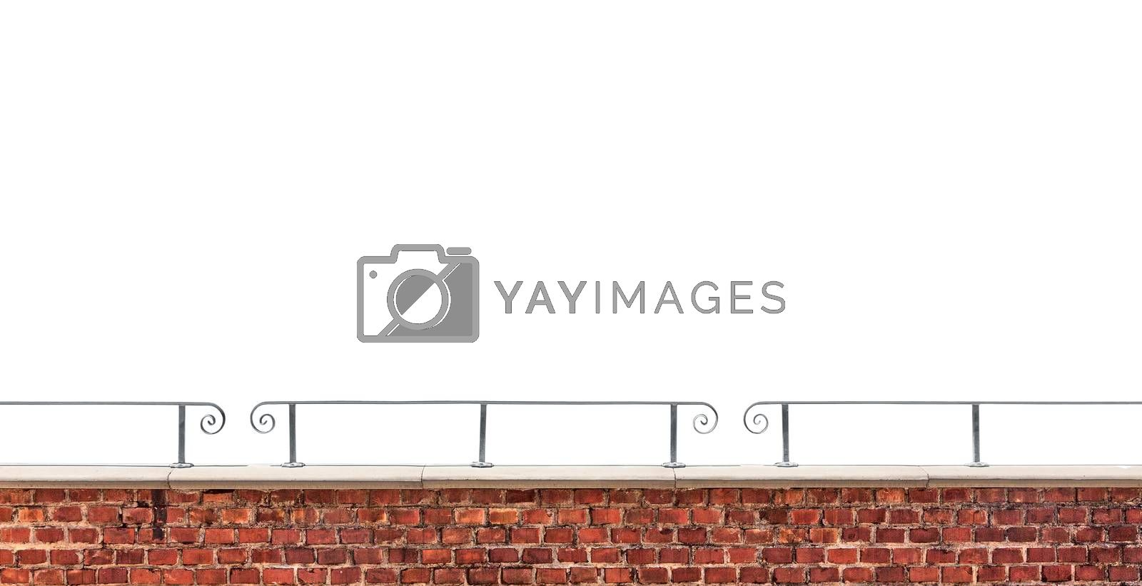 Old brick wall fragment and metal railing isolated on white background