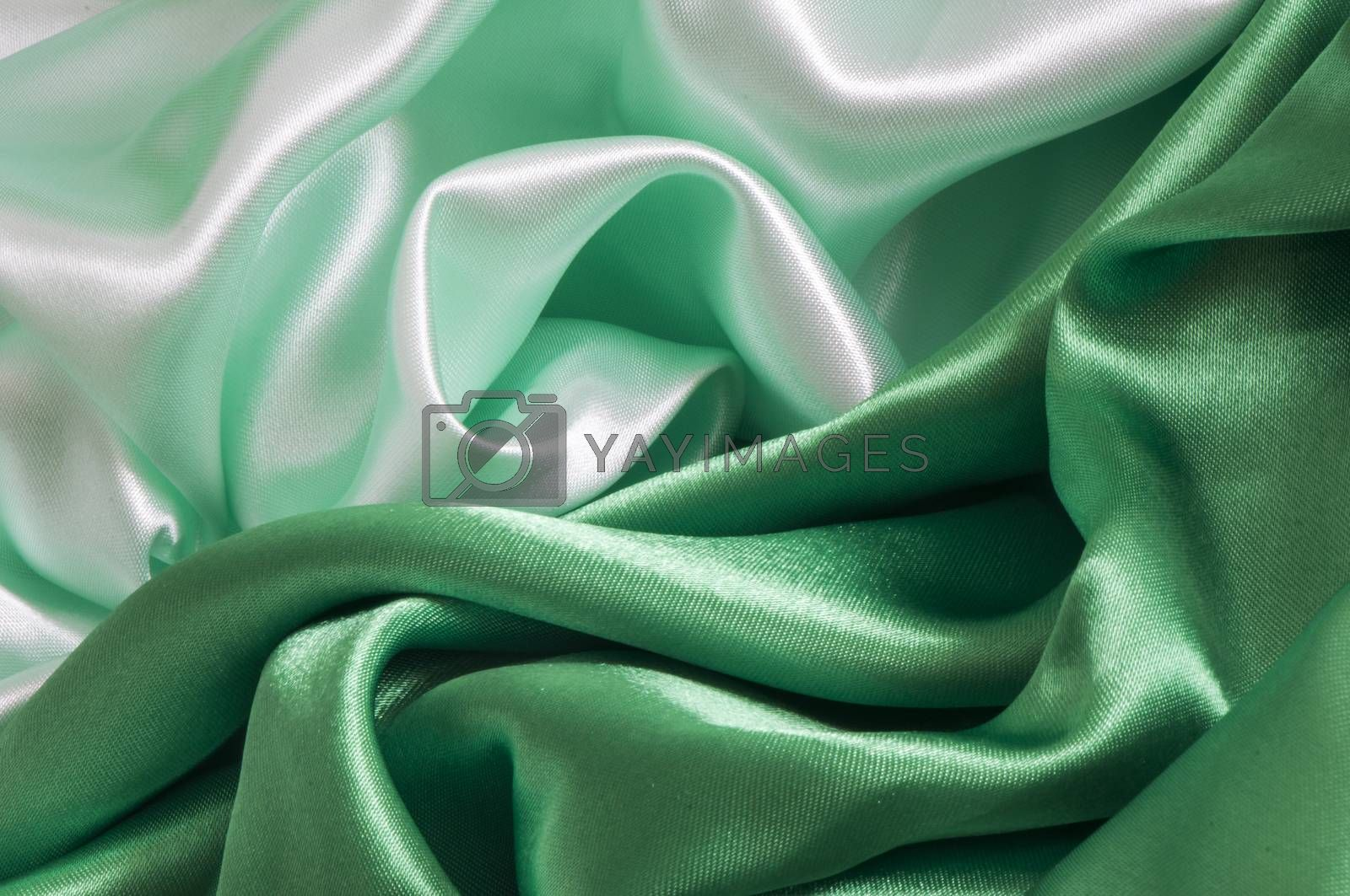 a elegant background with a green fabric