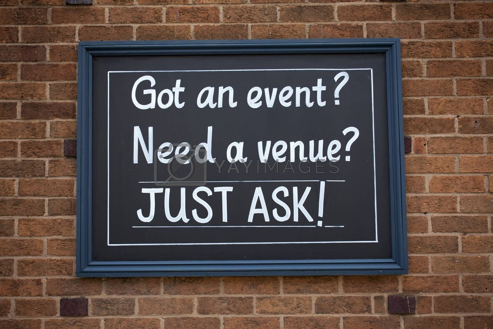 Royalty free image of Sign got an event, need a venue just ask on the street. by artursz