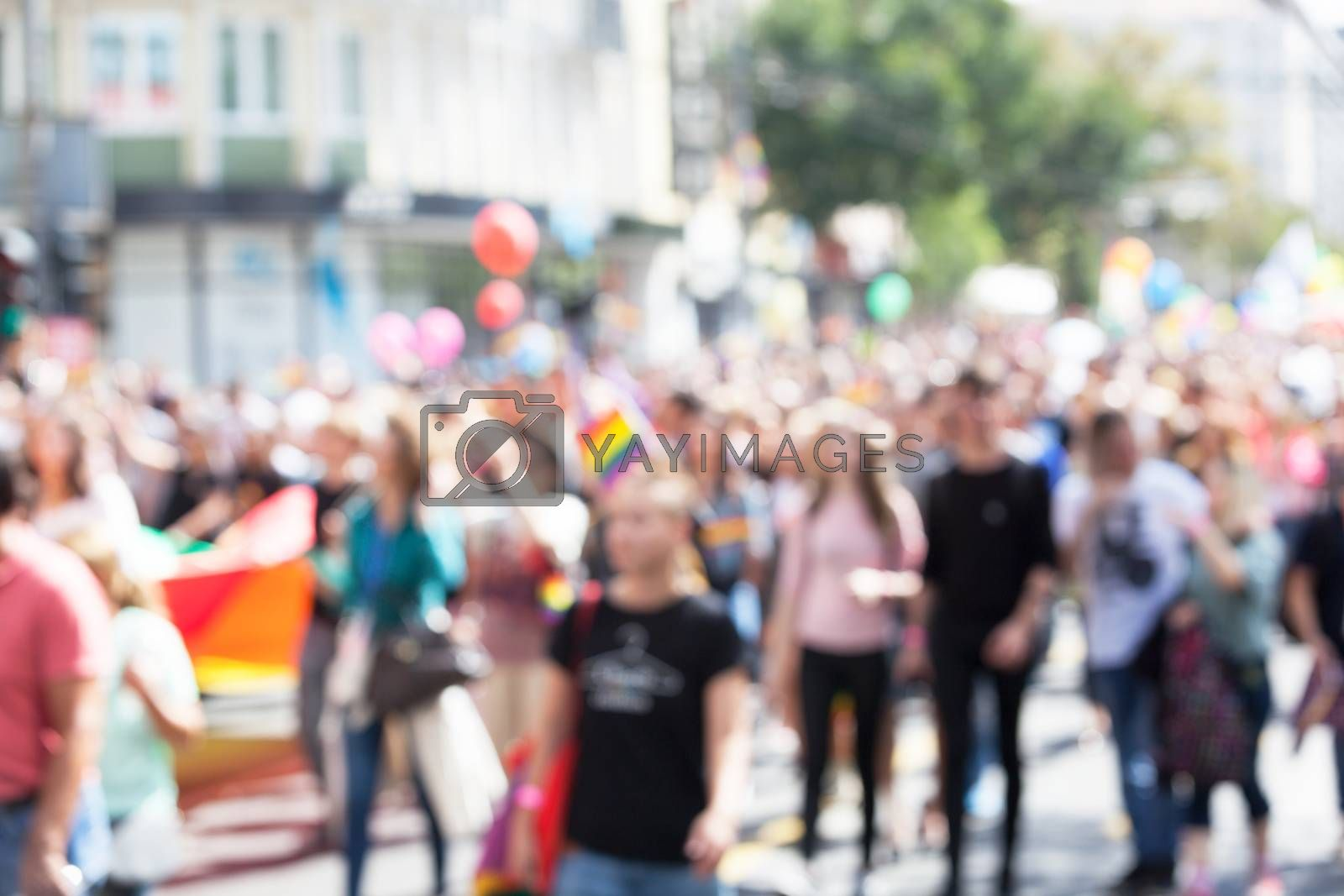 Blurred picture of participants of LGBT parade