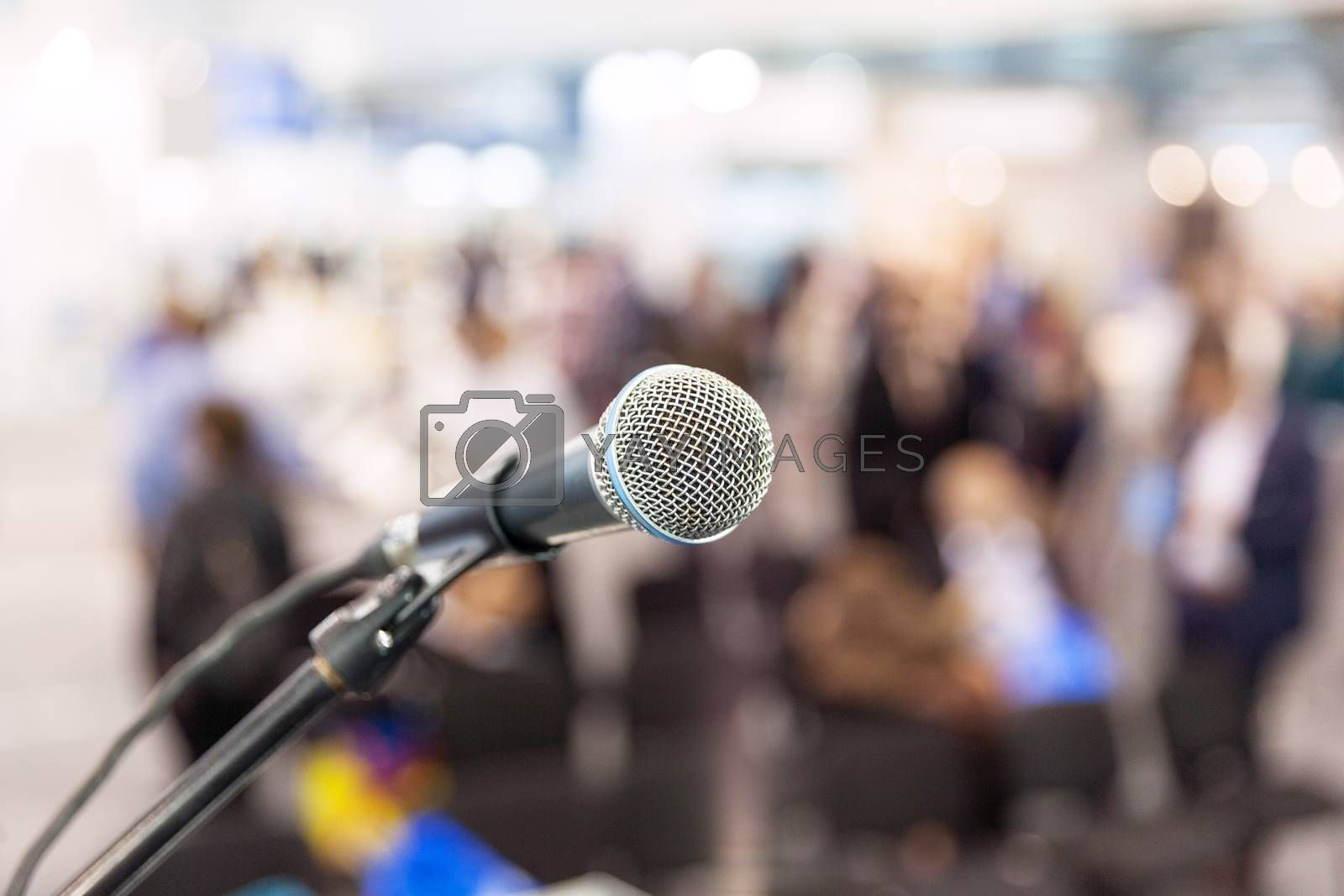 Microphone in focus against blurred people. Press conference.