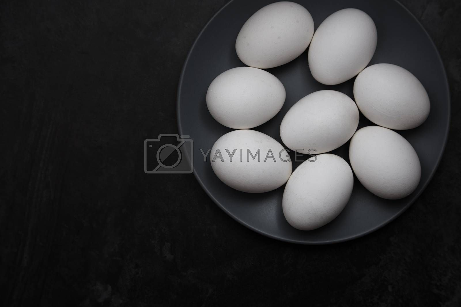 Chicken eggs on a plate. View from above