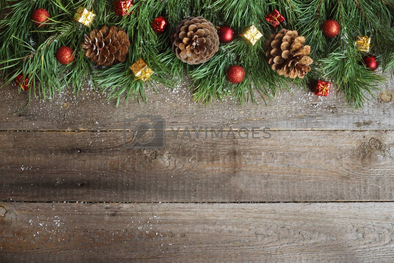 Christmas card on wooden background by Liubov Mikhaylova